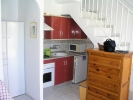 Extended terraced property situated in La Marina urbanisation.  1 bedroom, 2 bathrooms
